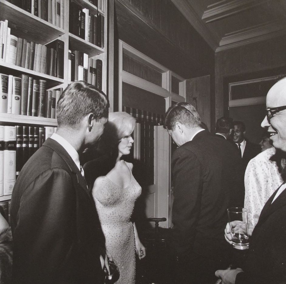 """This photo provided by Bonhams auction house, by former White House photographer Cecil Stoughton, shows Marilyn Monroe with President John F. Kennedy, center, and Robert Kennedy, left, at a Democratic fundraiser on May 19, 1962 at a home in New York City. Monroe had come straight from Madison Square Garden where she had sung """"Happy Birthday"""" to the president.  It is one of a trove of JFK photos being offered by Stoughton's estate at Bonhams auction house in New York, Thursday, Dec. 9, 2010. (AP Photo/Bonhams, Cecil Stoughton)"""