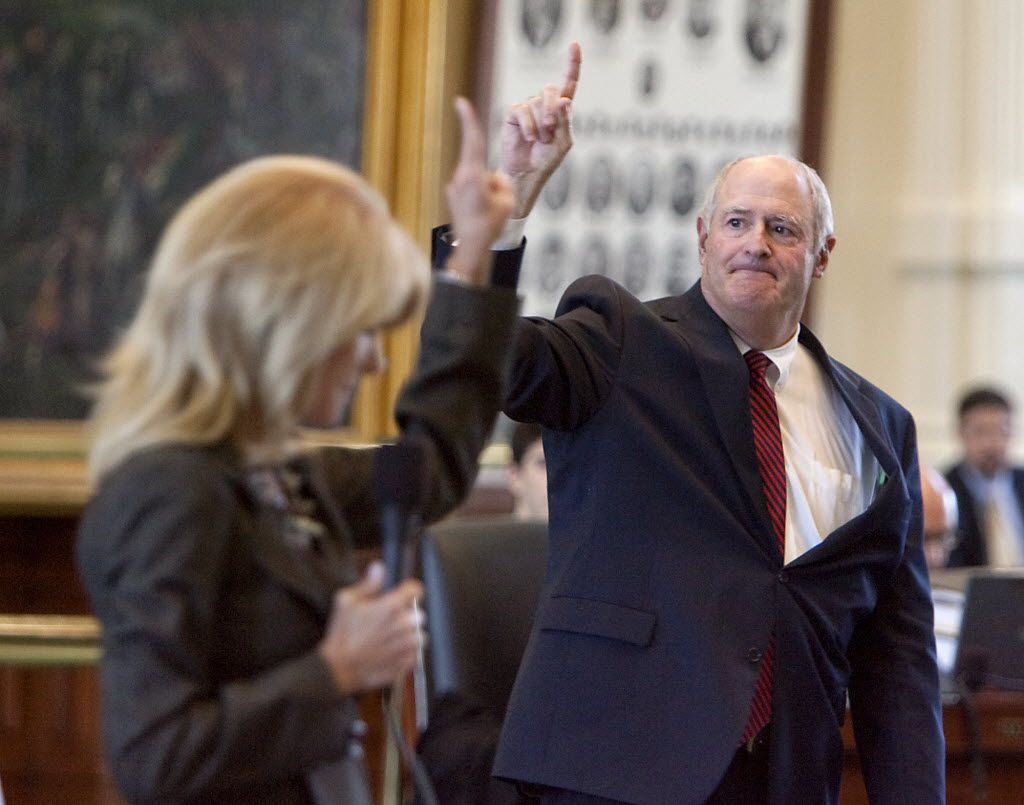 Texas Senators Wendy Davis, D-Fort Worth, left, votes two fingers, nay as Sen. Kel Seliger, R-Amarillo, votes one finger, aye, during debate over redistricting on the senate floor held at the State Capitol in Austin, Texas, on Tuesday, May 17, 2011. Sen. Seliger tabled both of Sen. Davis' two amendments to his redistricting Senate Bill 31.