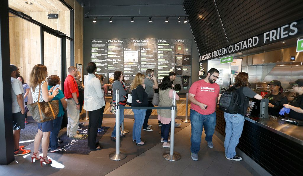 Patrons line up at Shake Shack at Legacy West in Plano. Amazingly, the lines weren't super long on opening day, March 29, 2017.