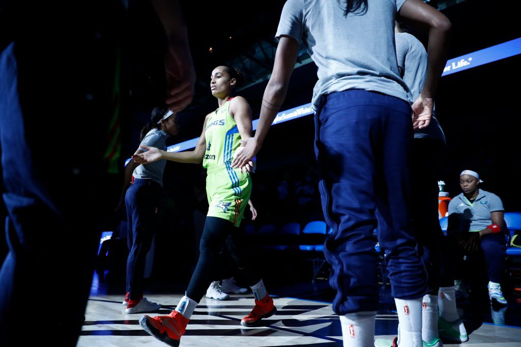 Dallas Wings guard Skylar Diggins (4) being introduced onto the court before a WNBA basketball game between the Chicago Sky and the Dallas Wings at College Park Center on Aug. 28, 2016 in Arlington, Texas. (Ting Shen/The Dallas Morning News)