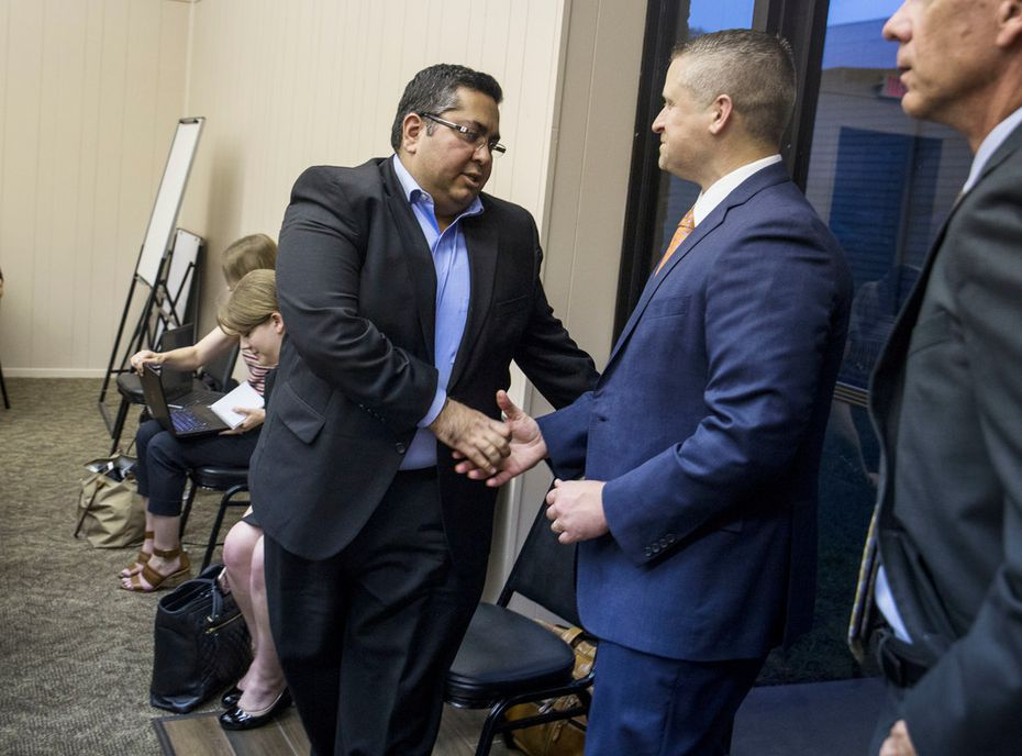 Asad Rahman, general counsel of the Islamic Association of Collin County, (left) shook hands with Matthew Kacsmaryk, deputy general counsel for First Liberty Institute, after the Farmersville City Council's vote on Thursday.