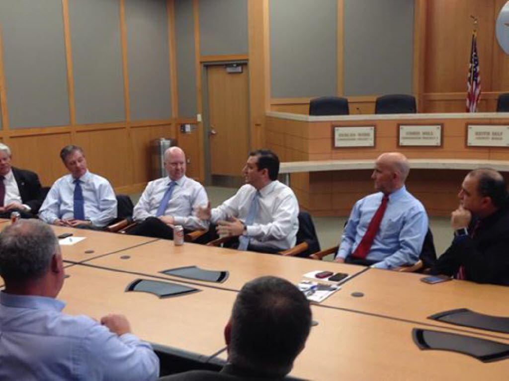 Collin County Commissioner Chris Hill (third from left) listened as Sen. Ted Cruz met with a number of county officials in 2014. Pictured (from left): Allen Mayor Steve Terrell, Collin County commissioners Mark Reid and Hill, Cruz, Collin County Judge Keith Self and Frisco Mayor Maher Maso.