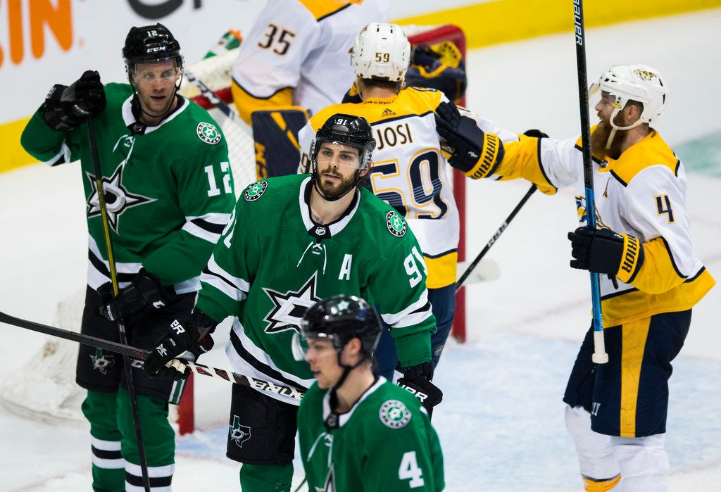 Dallas Stars center Tyler Seguin (91), center Radek Faksa (12) and defenseman Miro Heiskanen (4) react as time runs out during the third period of Game 3 of a playoff series between the Dallas Stars and the Nashville Predators on Monday, April 15, 2019 at American Airlines Center in Dallas. The Dallas Stars lost 3-2. (Ashley Landis/The Dallas Morning News)
