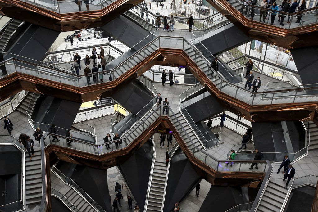 Visitors walk through the Vessel, a public art structure consisting of 155 flights of stairs, on the opening day for phase one of the Hudson Yards development.