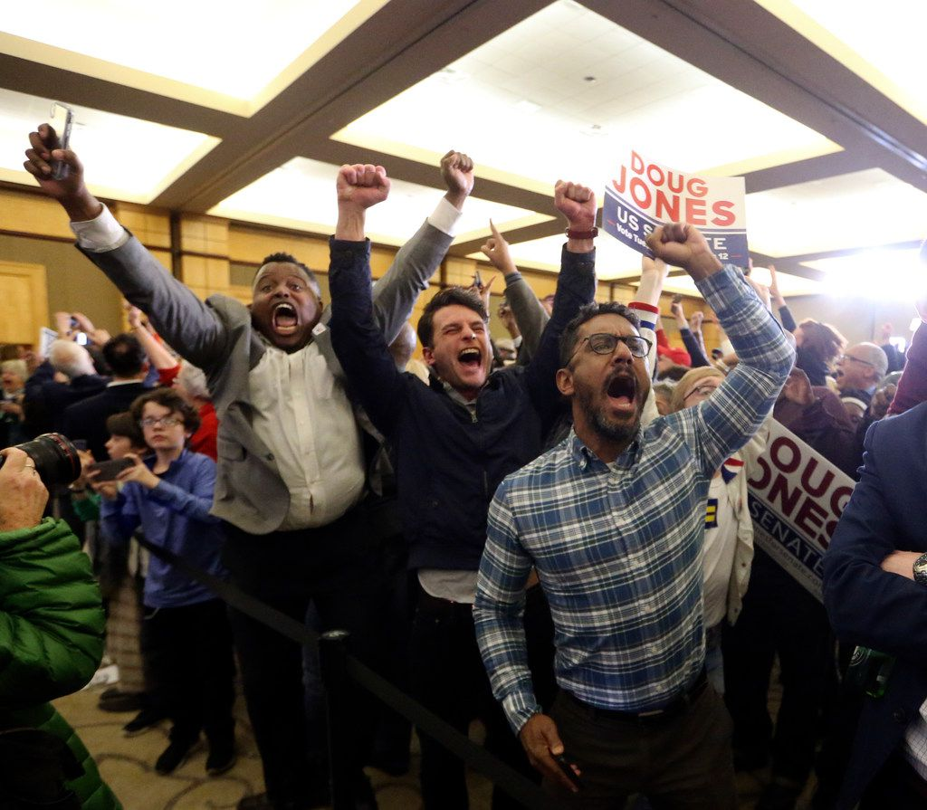 Supporters of Democratic candidate for U.S. Senate Doug Jones react during an election-night watch party Tuesday, Dec. 12, 2017, in Birmingham , Ala. Jones is facing Republican Roy Moore. (AP Photo/John Bazemore)