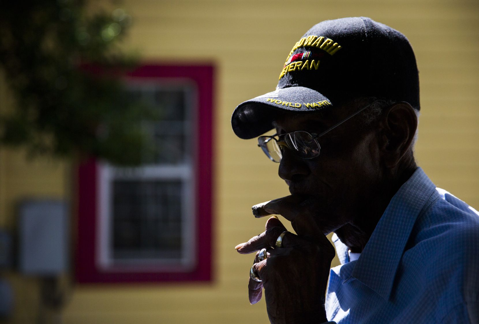 U.S. Army veteran Richard Overton, then 111, sat on the front porch smoking a cigar on May 5, 2018, at his home in Austin.