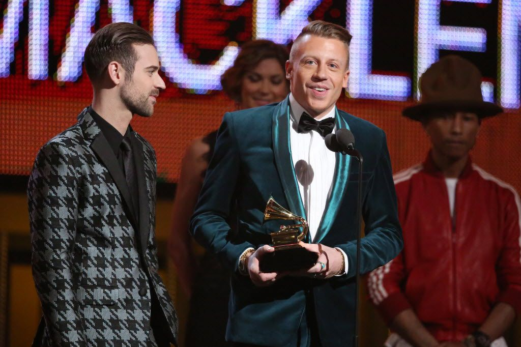 Ryan Lewis, left, and Macklemore accept the award for best new artist at the 56th annual Grammy Awards at Staples Center on Sunday, Jan. 26, 2014, in Los Angeles.