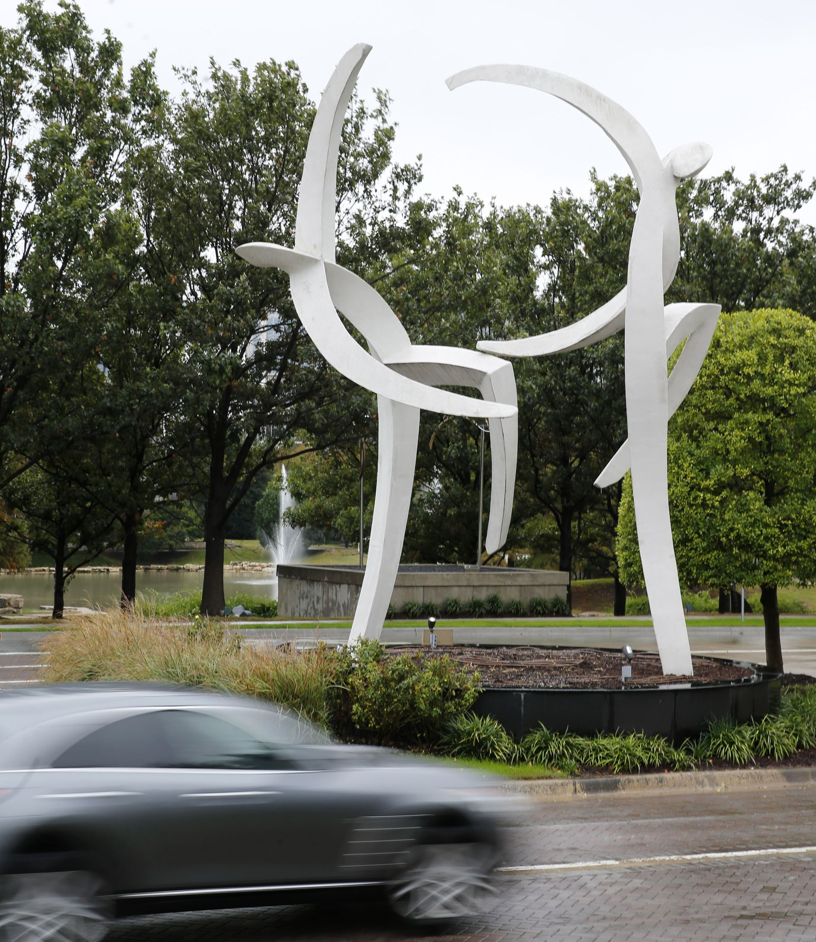 """Dancers MM,"" by artist Jerry Daniel, is the entry sculpture at Hall Office Park and the Texas Sculpture Garden in Frisco as well as the inspiration for the park's logo."