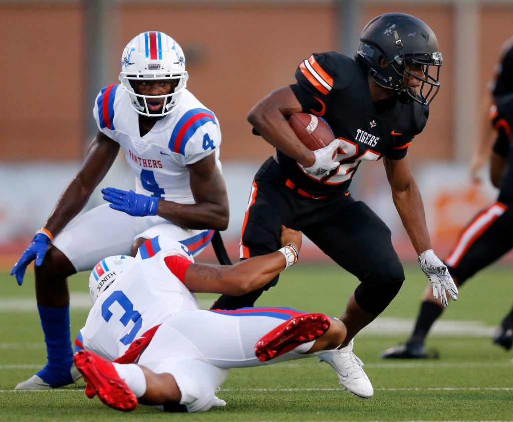 Duncanville quarterback Ja'Quinden Jackson (3) tries to tackle Lancaster defensive back Barry Green (22) after throwing a first quarter interception at Beverly D. Humphrey Tiger Stadium in Lancaster Texas, Friday, August 30, 2019. (Tom Fox/The Dallas Morning News)