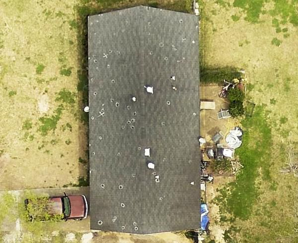 An EagleView photo shows hail damage in Jackson, Miss. The company has built a photo library of the country's rooftops.