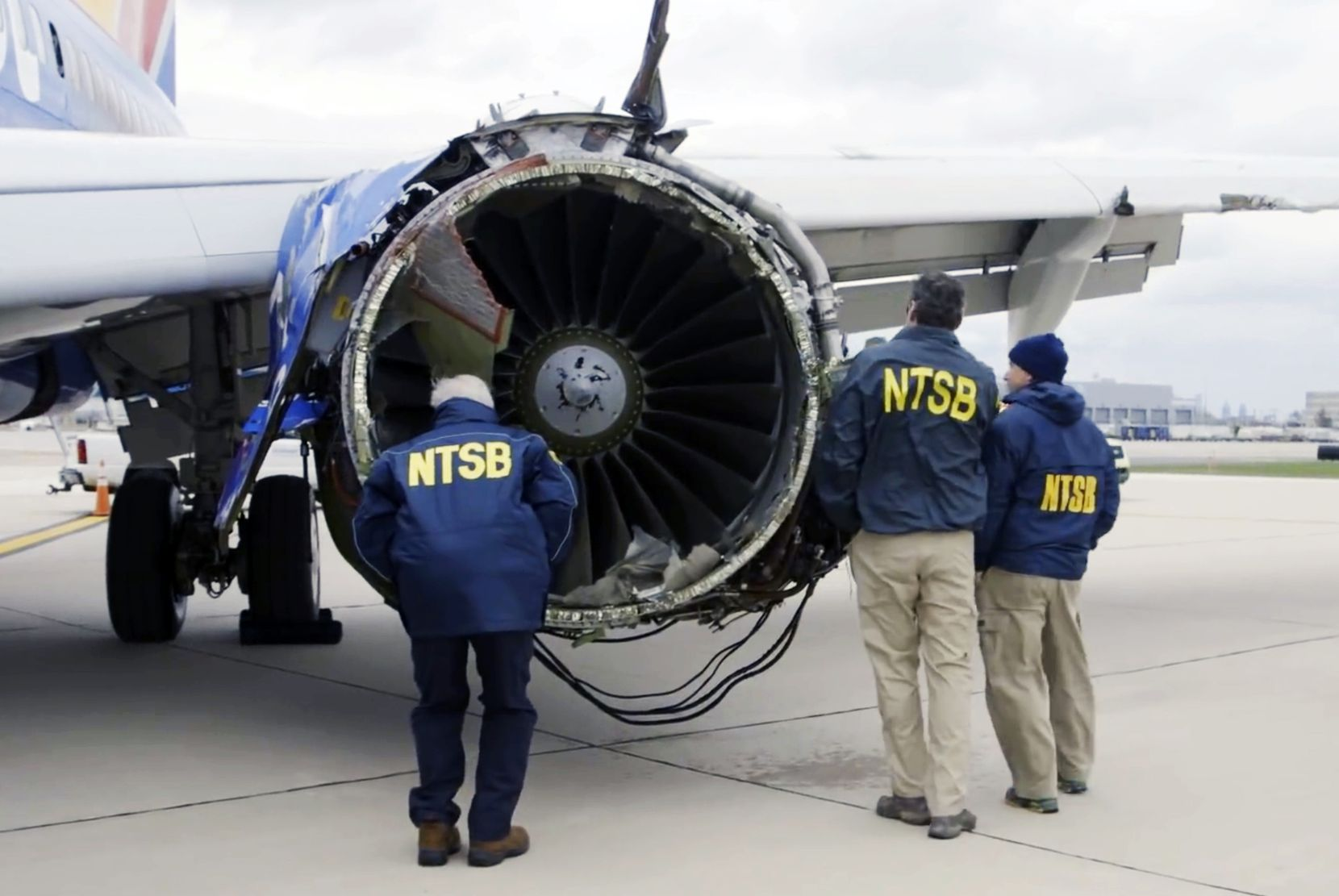 Investigators in Philadelphia examine the damaged engine that caused the death of a passenger on a Southwest Airlines plane on  April 17, 2018. The engine on the plane broke apart shortly after takeoff from La Guardia Airport in New York, killing a woman sitting in a window seat near the blast. (NTSB)