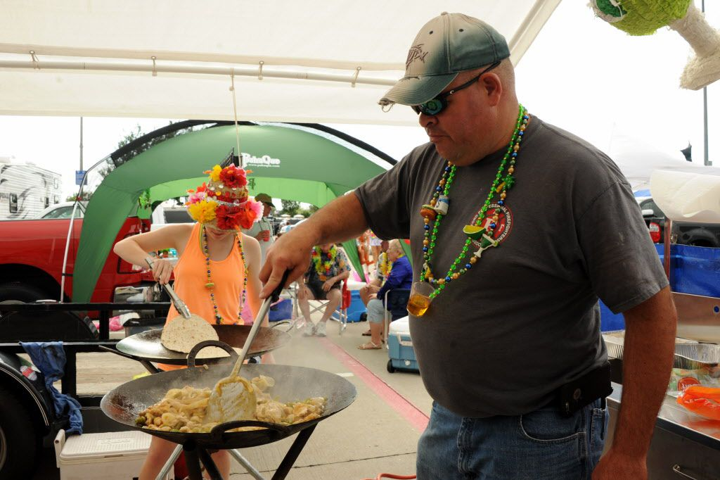 Walt Greenwade grills chicken fajitas at the Jimmy Buffett tailgate party at Toyota Stadium in Frisco, TX on May 30, 2015.