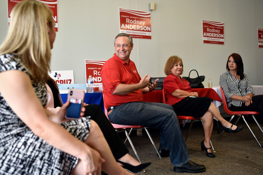Republican Rep. Rodney Anderson (left) speaks with colleagues during an interview on Aug. 8 in Irving.