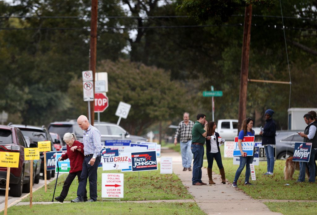 Voters leave the polling station at Geneva Heights Elementary School in Dallas on election day, Tuesday, Nov. 6, 2018.