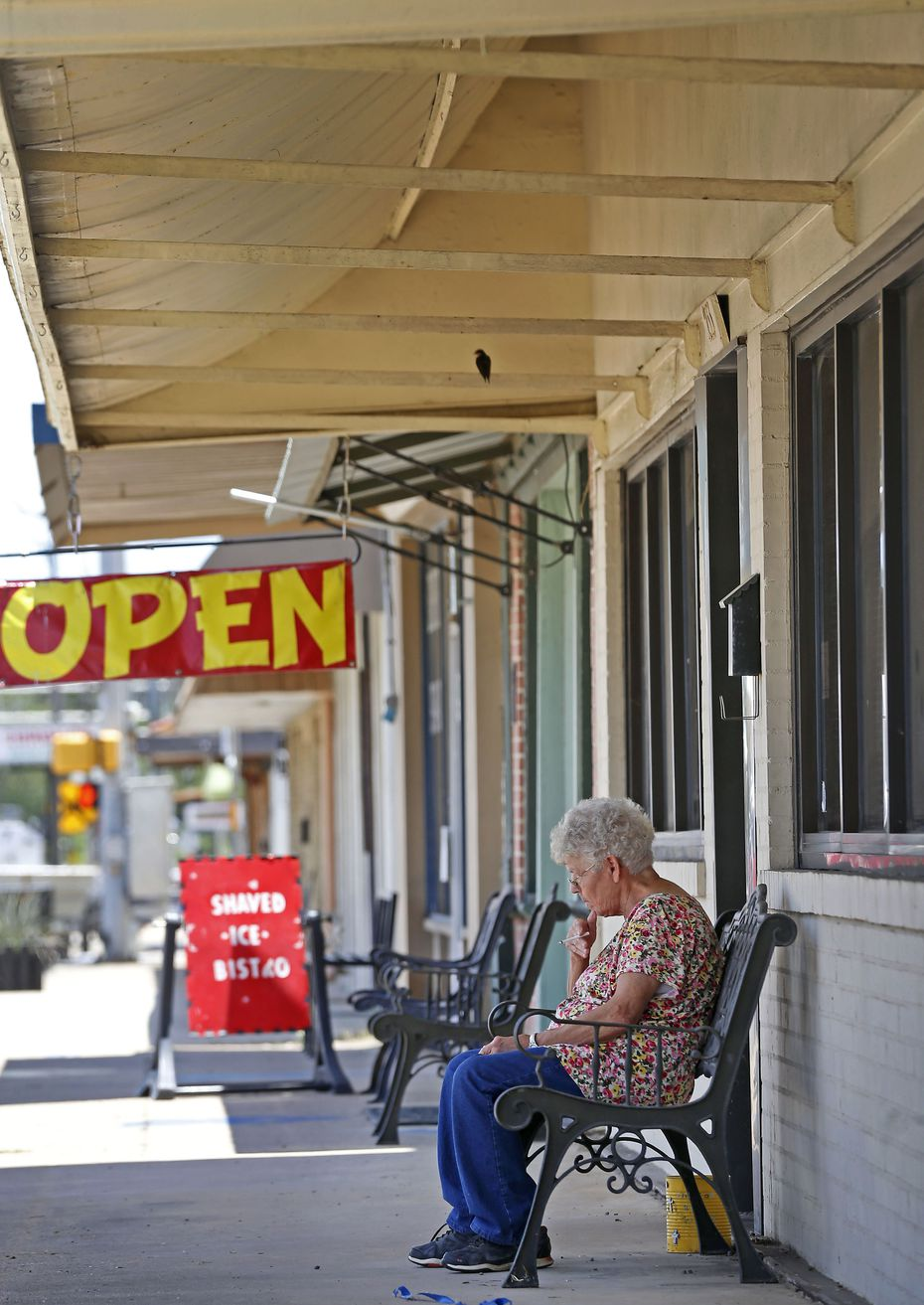 Resident Mary Beyer takes a smoke break in downtown Rockdale, Texas, Thursday, June 14, 2018.