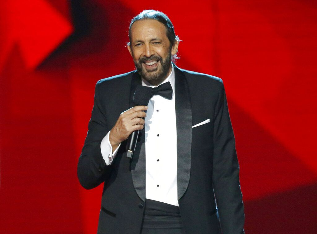 """FILE – This April 25, 2019 file photo shows Juan Luis Guerra accepting a lifetime achievement award at the Billboard Latin Music Awards in Las Vegas. Guerra releases his 16th album, """"Literal,"""" on Friday, May 31. (Photo by Eric Jamison/Invision/AP, File)"""