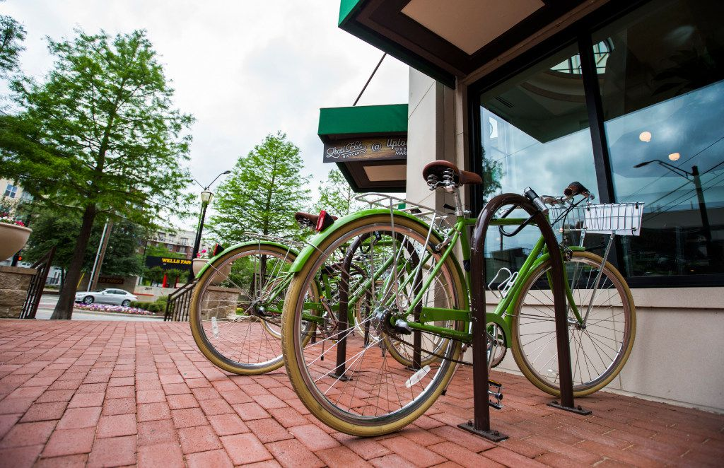 Rental bicycles are parked in front of Uptown Urban Market on Saturday, April 15, 2017 on Cedar Springs Road in Dallas. The new food hall includes Fireside Pies, La Duni Baking & Coffee Studio, The Hot Counter, Bar Up, Buda Juice, The Cupboard Grab & Go, Ill Minster bar and Bicycle Hub Company.