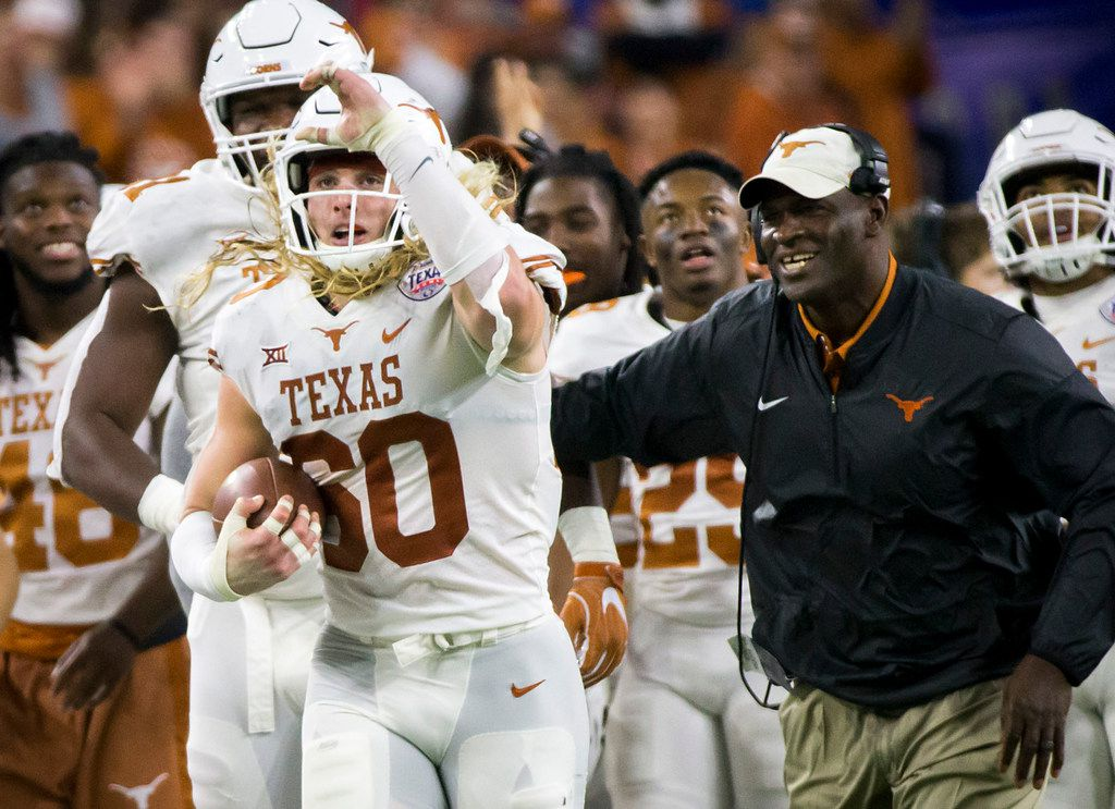 Texas linebacker Breckyn Hager, who is wearing the No. 60 to honor late Longhorns great Tommy Nobis, celebrates after recovering a fumble by Missouri tight end Albert Okwuegbunam (81)  during the second quarter of the Texas Bowl on Wednesday, Dec. 27, 2017, in Houston. (Smiley N. Pool/The Dallas Morning News)