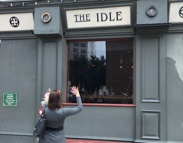 """Sarah Blaskovich and her daughter, Hayley Hanna, wave """"bye"""" to Idle Rich Pub, which closes in Dallas on Jan. 23, 2018."""
