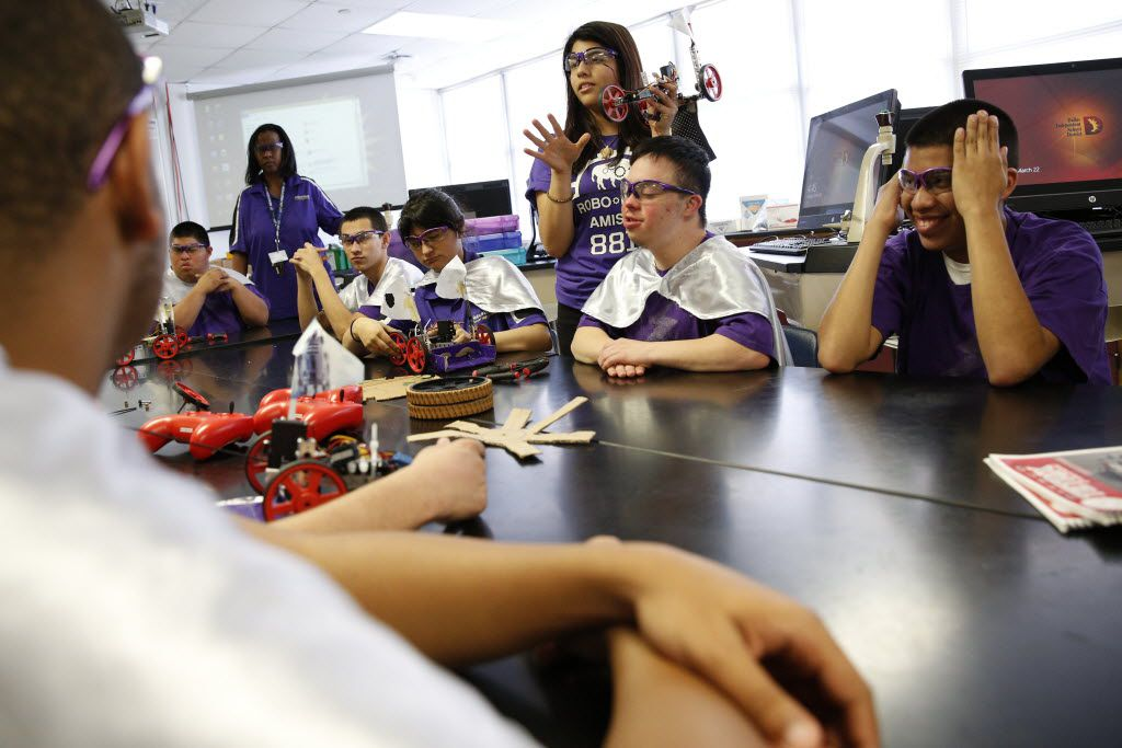 Senior Ivonne Torres, captain of the robotics team, speaks to special education students during an after-school session at Sunset High School in Dallas on March 22, 2016. Sunset High School has developed a robotics team for special education students to help provide students with exposure to STEM skills. (Rose Baca/Staff Photographer)