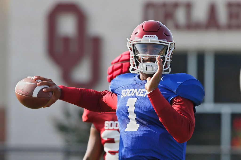 FILE - In this Monday, Aug. 5, 2019, file photo, Oklahoma quarterback Jalen Hurts throws during an NCAA college football practice in Norman, Okla. Hurts is competing with Tanner Mordecai, a redshirt freshman, and Spencer Rattler, a true freshman, to become starting quarterback.(AP Photo/Sue Ogrocki, File)