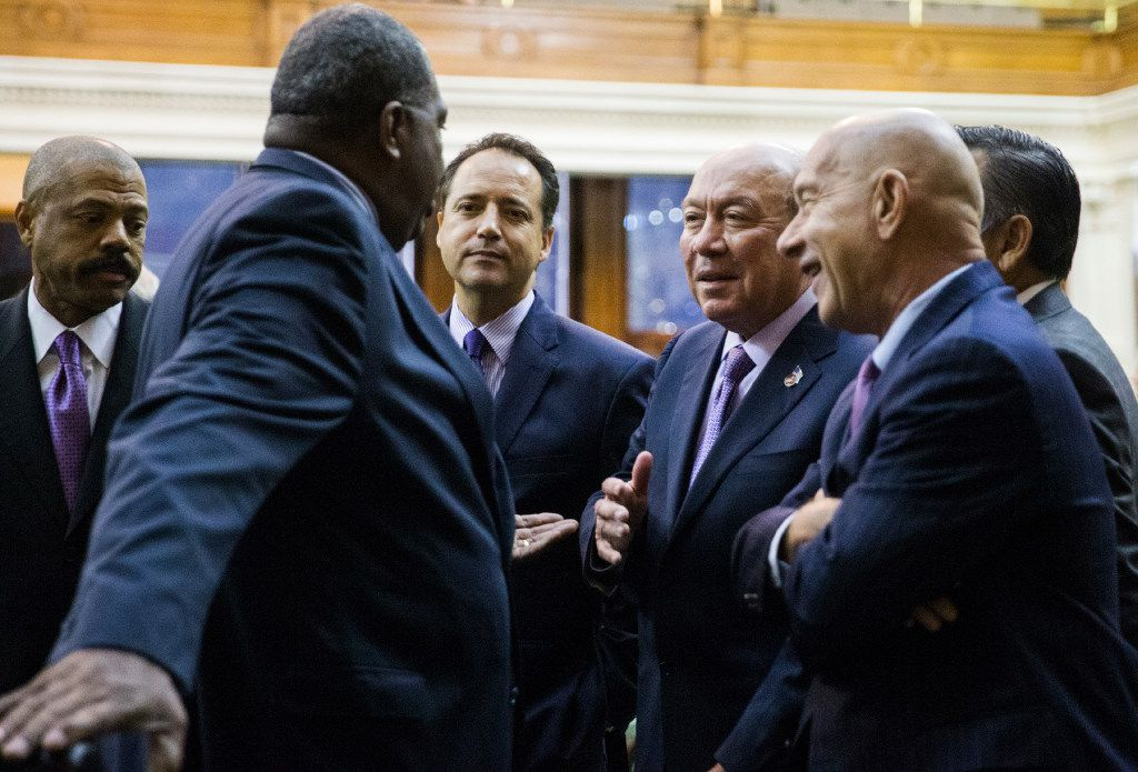 Senators chat during a midnight special session meeting on the third day of a special legislative session on Thursday, July 20, 2017 at the Texas state capitol in Austin.