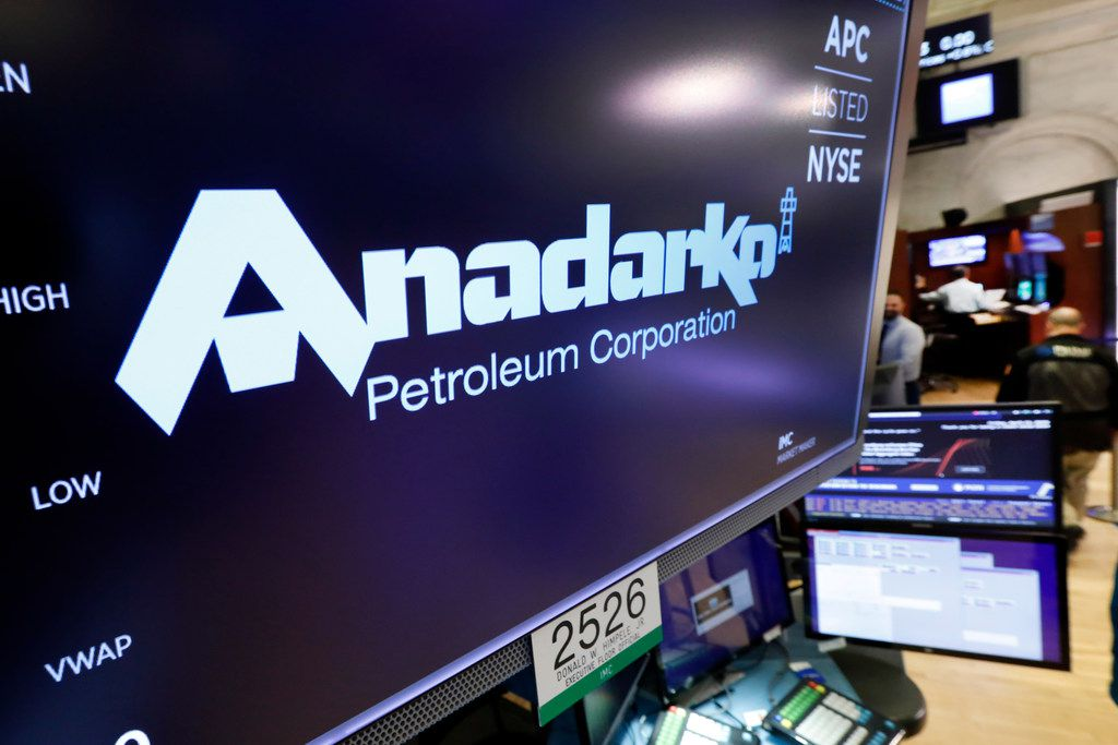 The logo for Anadarko Petroleum Corp. appears above a trading post on the floor of the New York Stock Exchange, Friday, April 12, 2019. Energy companies rallied after Chevron said it would pay $33 billion to buy rival Anadarko Petroleum. (AP Photo/Richard Drew)