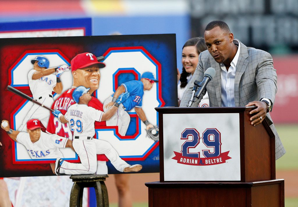 Retired player Adrian Beltre, right, speaks during a jersey retirement ceremony for him before the second baseball game of a doubleheader against the Oakland Athletics in Arlington, Texas, Saturday, June 8, 2019. (AP Photo/Roger Steinman)