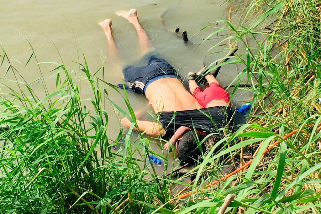 The bodies of Salvadoran migrant Oscar Alberto Marti­nez Rami­rez and his nearly 2-year-old daughter Valeria lie on the bank of the Rio Grande in Matamoros, Mexico, Monday, June 24, 2019, after they drowned trying to cross the river to Brownsville, Texas. Martinez's wife, Tania, told Mexican authorities she watched her husband and child disappear in the strong current. This photograph was first published in the Mexican newspaper La Jornada.