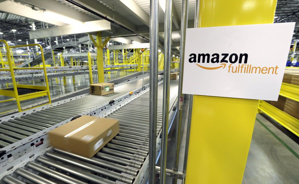A package moves along a conveyer belt at an Amazon fulfillment center in DuPont, Wash.
