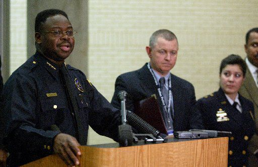 Dallas Police Chief Terrell Bolton (left) spoke at a news conference in April 2003 with Lt. Craig Miller at his side to announce the termination of narcotics officer Mark A Delapaz and new guidelines for drug cases.