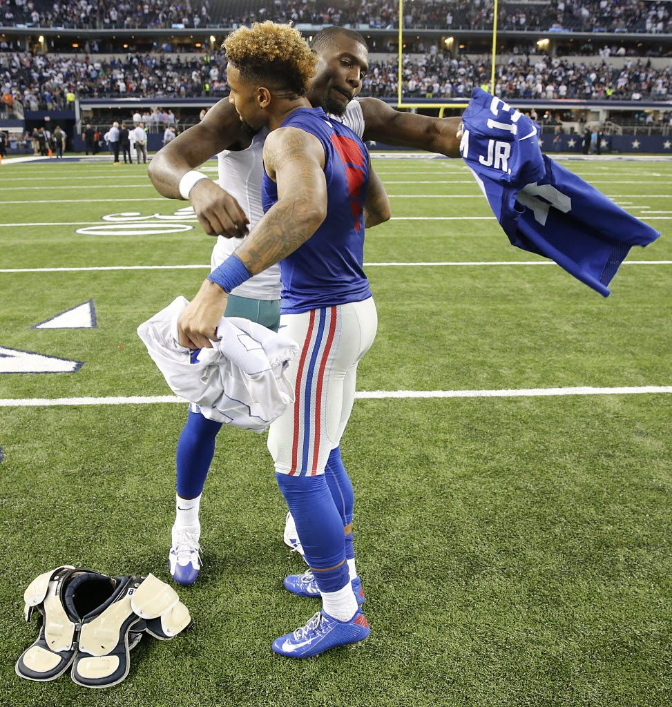 Former Dallas Cowboys wide receiver Dez Bryant and New York Giants wide receiver Odell Beckham Jr. hug as they exchange jerseys after a game at AT&T Stadium in 2014. Beckham Jr. has joined Colin Kaepernick and other athletes in a new ad campaign from Nike.