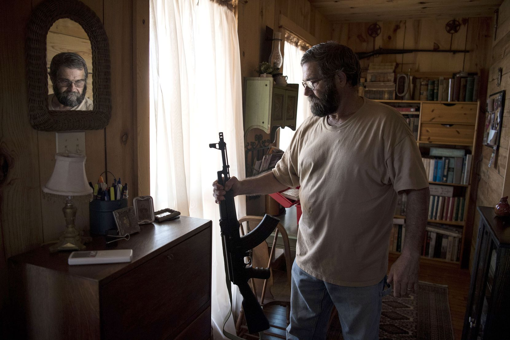 """Sutherland Springs resident Kevin Langdon owns about 50 guns. In the small town, he said, """"Everyone has everyone else's back, and guns are how we keep one another safe."""""""