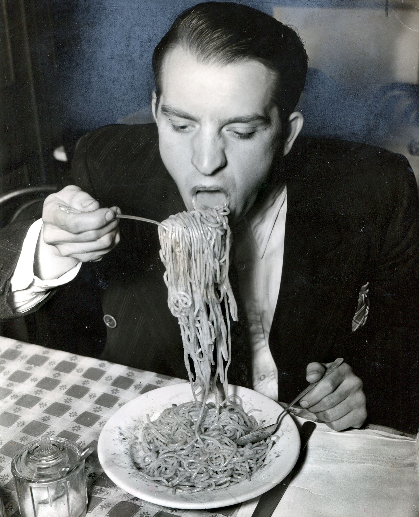 Weegee's 1940 image of Phillip J. Stazzone devouring his favorite food.
