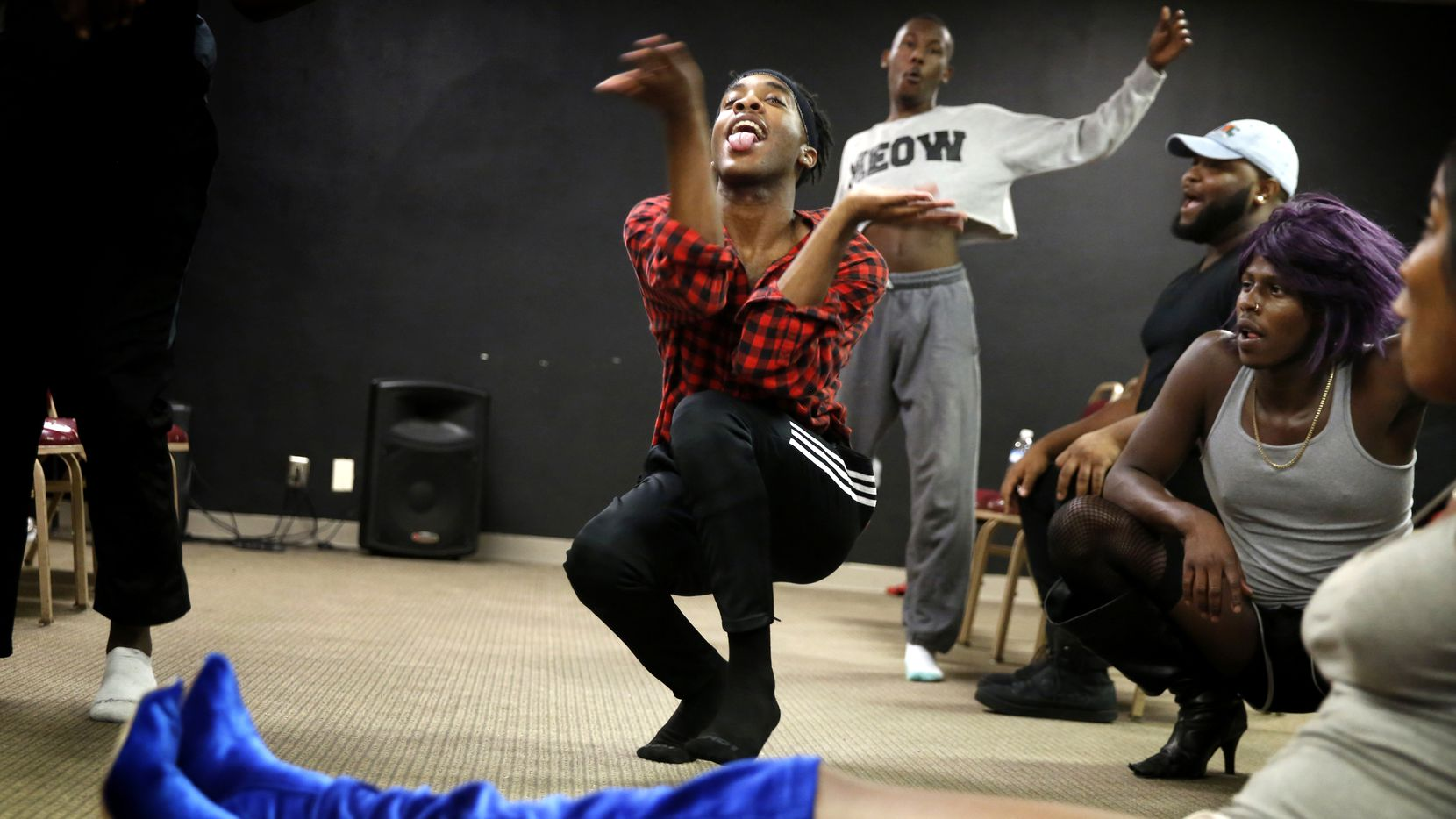 Leondrae Frank (center) vogues with others during a voguing practice at United Black Ellument in Dallas on Aug. 10, 2018. (Rose Baca/The Dallas Morning News)