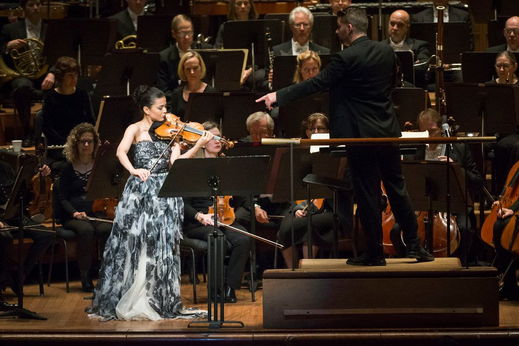 Guest conductor Matthias Pintscher points to violin soloist Karen Gomyo as she performs with the Dallas Symphony Orchestra at the Morton H. Meyerson Symphony Center on Thursday, Jan. 5, 2017, in Dallas. (Smiley N. Pool/The Dallas Morning News)