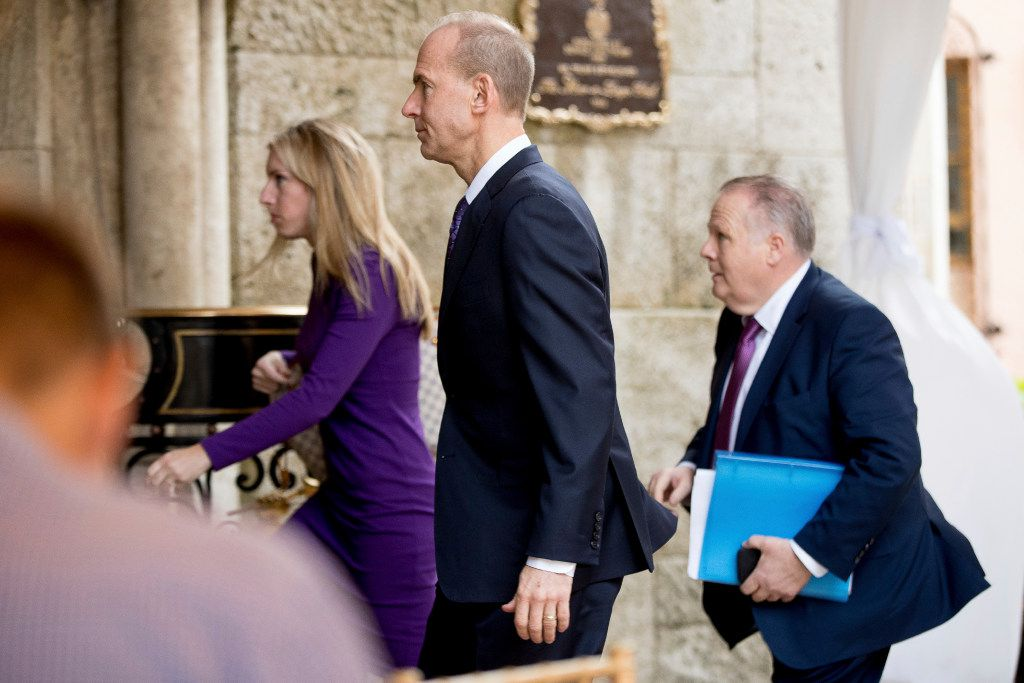 Boeing CEO Dennis Muilenburg (center) arrives for a meeting with President-elect Donald Trump in Palm Beach, Fla., on Wednesday. (Andrew Harnik/The Associated Press)