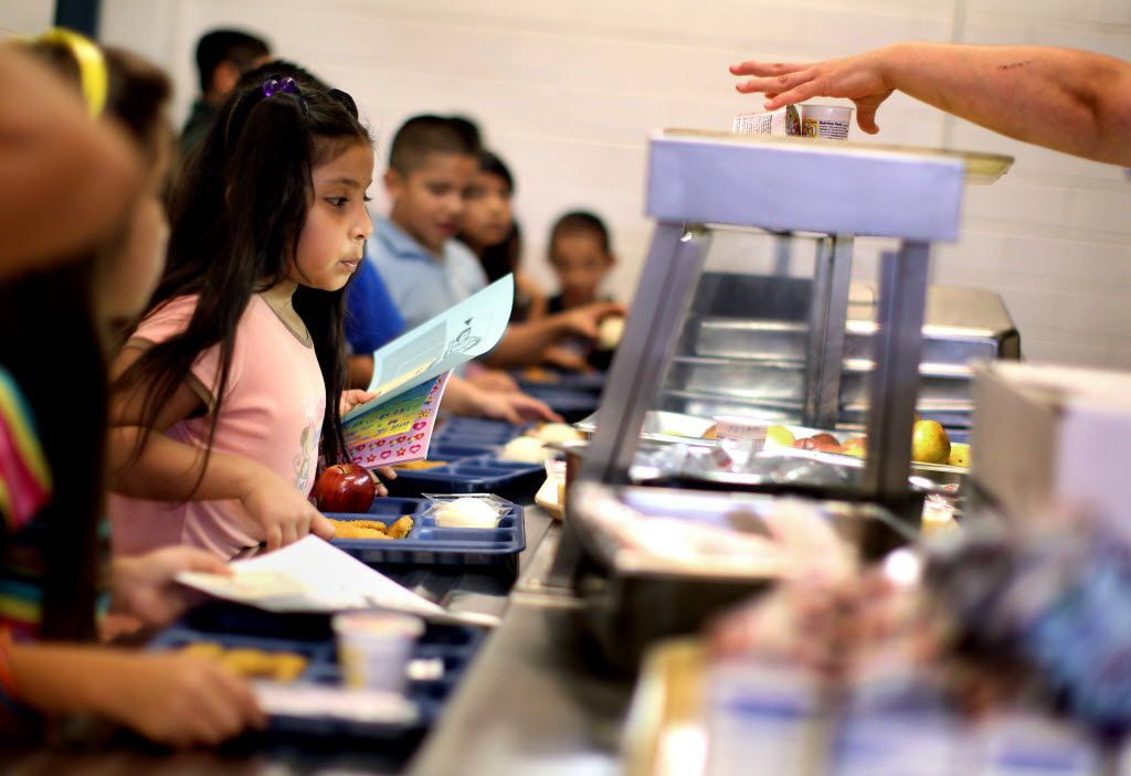 Alexandra Gonzalez, who will be in 2nd grade this fall, waits in line for a free lunch with her classmates on the last day of a summer school program at John R. Good Elementary School in Irving July 1, 2010.