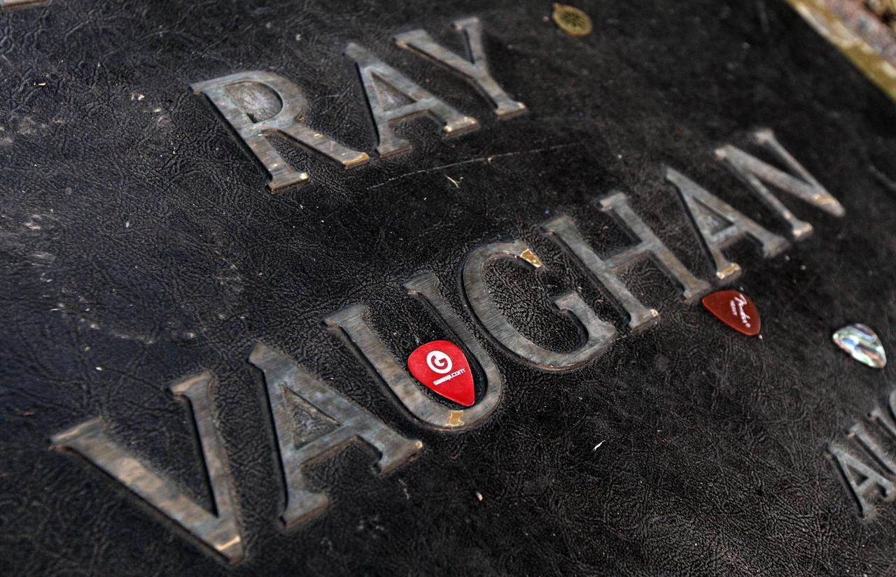 Guitar picks are placed on the grave marker of Stevie Ray Vaughan at Laurel Land Memorial Park in south Dallas in 2010. (G.J. McCarthy/Staff Photographer)