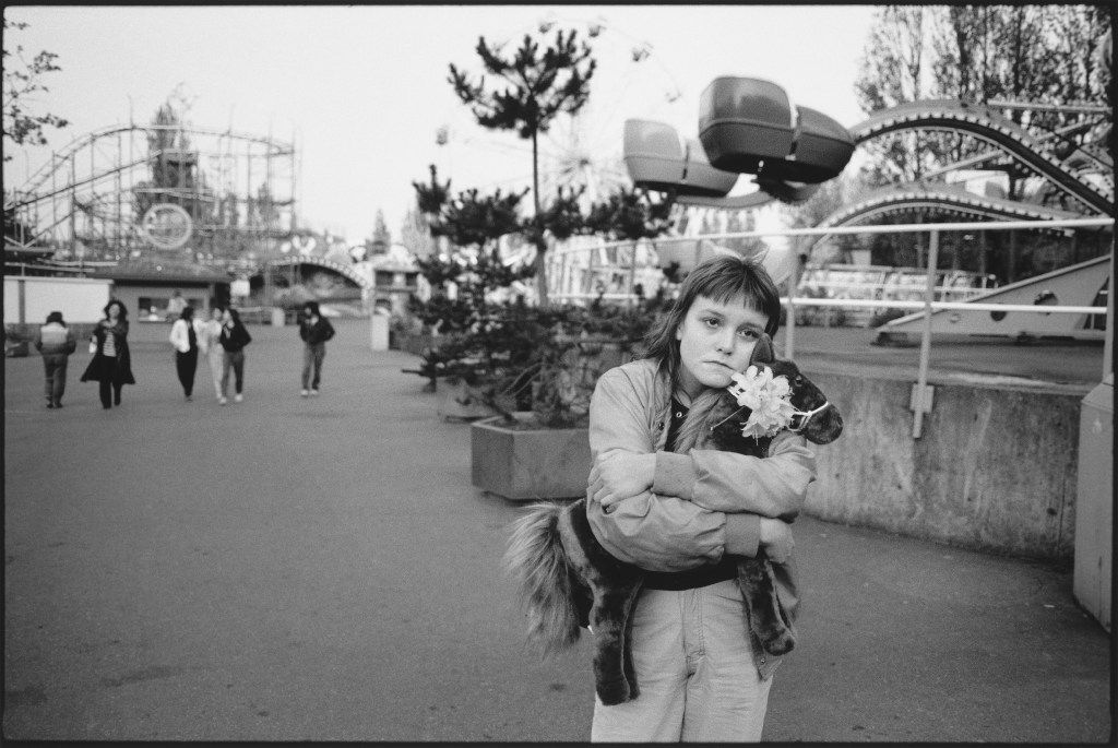 Photos of Tiny, by Mary Ellen Mark. Tiny at the amusement park with    Horsie,    Seattle, 1983