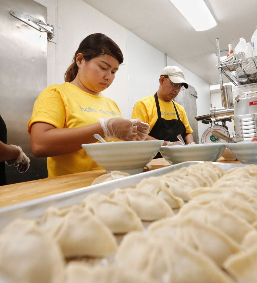 Ja Seng Pan, left, and Sin Kalay Marip assemble fish and beef dumplings at Hello Dumpling in Dallas.