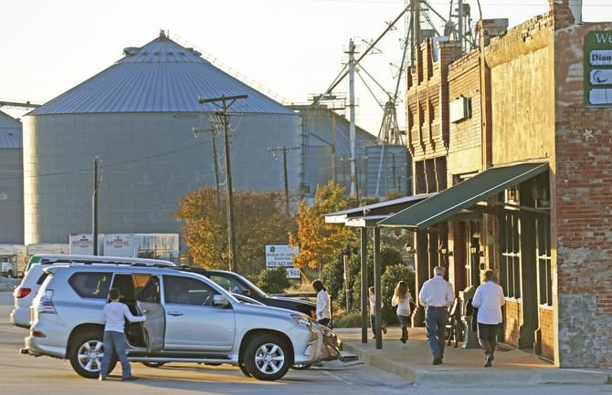 The idyllic atmosphere  along Broadway in downtown Prosper belies the frenzy of development going on elsewhere. City leaders plan to use some of the revenue from new developments to preserve the old business district.