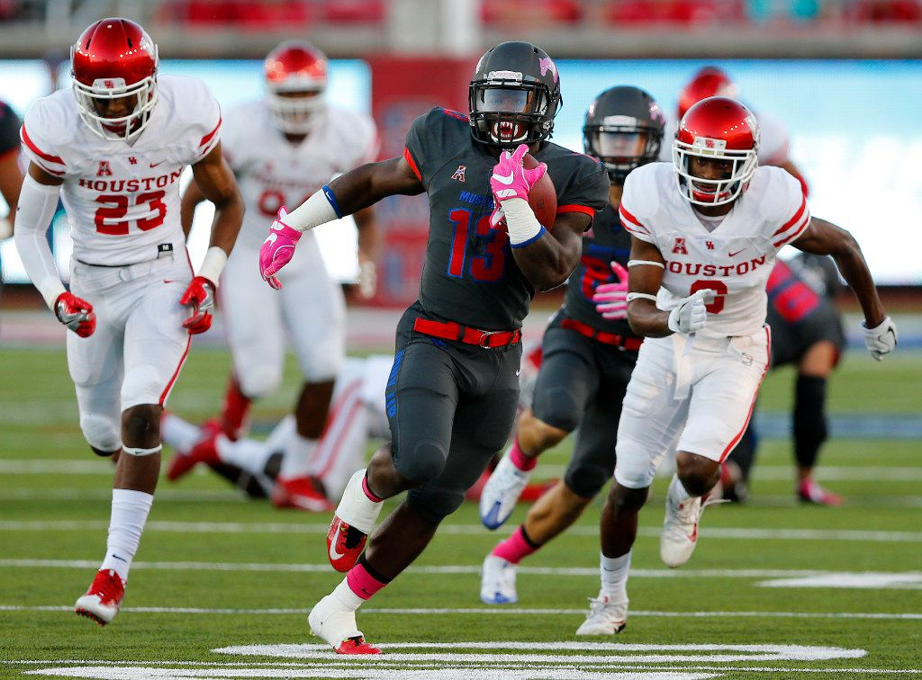 Southern Methodist Mustangs running back Ke'Mon Freeman (13) breaks away for a big run against the Houston Cougars in the first quarter at Gerald J. Ford Stadium in University Park, Texas, Saturday, October 22, 2016. (Tom Fox/The Dallas Morning News)