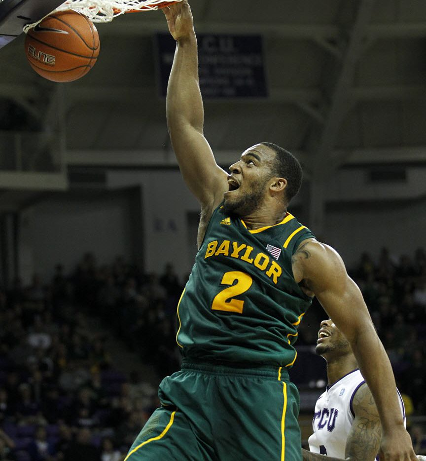 Baylor Bears forward Rico Gathers (2) slams the ball on a break away dunk against TCU in the first half at Daniel-Meyer Coliseum in Fort Worth, Saturday, January 26, 2013.  (Tom Fox/The Dallas Morning News)