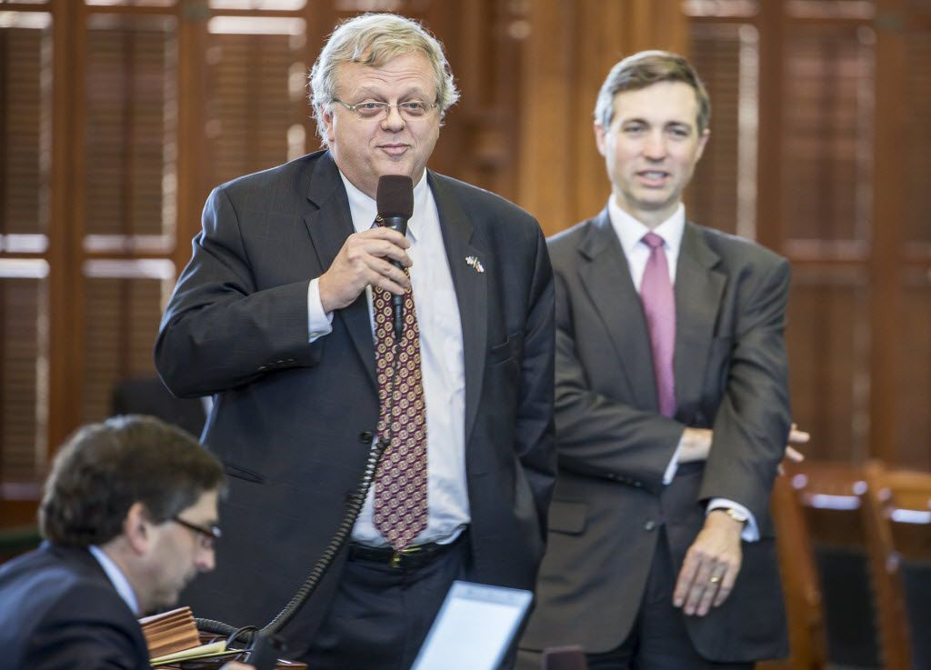 Sen. Paul Bettencourt debates tax cuts with Sen. Kirk Watson on the senate floor on Wednesday, March 25, 2015, in Austin, Texas. Sen. Van Taylor, right, looks on. (Ricardo B. Brazziell/Austin American-Statesman)