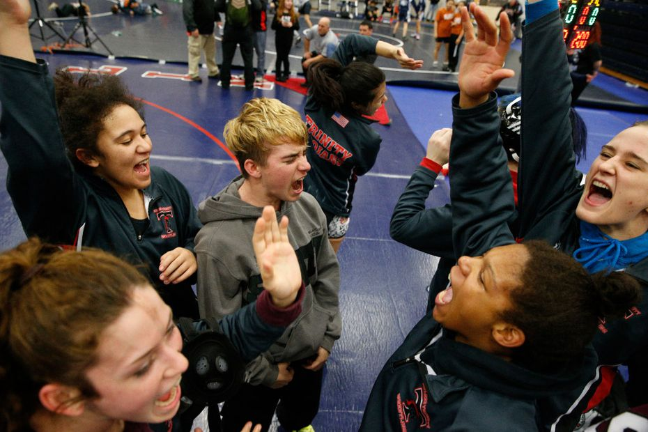 Euless Trinity's Mack Beggs (center) cheers with his team during the finals of the UIL Region 2-6A wrestling tournament at Allen High School in Allen, Texas on Friday, February 17, 2017.  (Nathan Hunsinger/The Dallas Morning News)