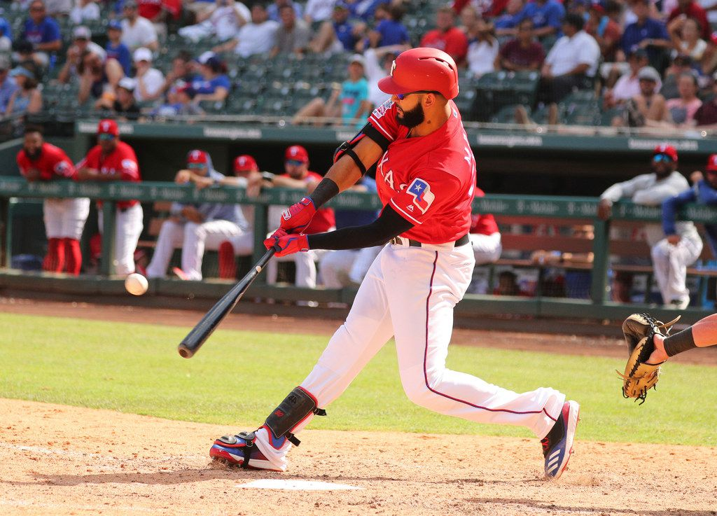Texas Rangers' Nomar Mazara hits an RBI-double that scored the go-ahead run against the Chicago White Sox in the eighth inning of a baseball game Sunday, June 23, 2019. (AP Photo/ Richard W. Rodriguez)