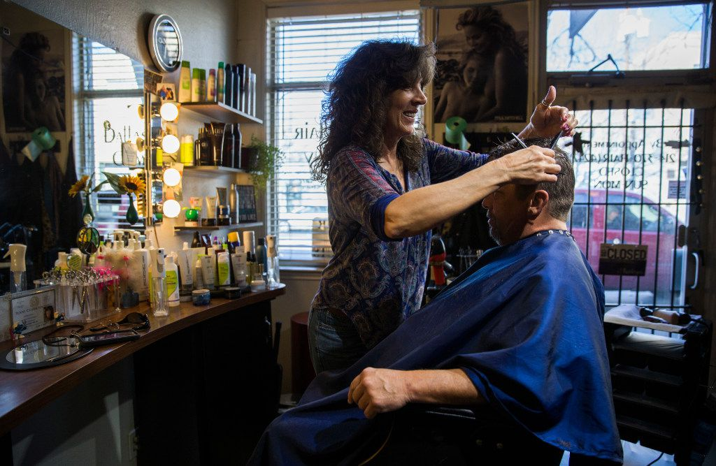 Tracey Newman, owner of Dallas Hair Company, gives a haircut to Mark Brock at her salon across the street from Fair Park on Saturday, January 28, 2017 on Exposition Avenue in Dallas.