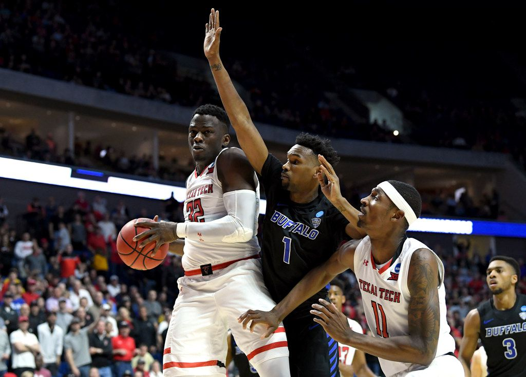 TULSA, OKLAHOMA - MARCH 24:  Norense Odiase #32 of the Texas Tech Red Raiders grabs the rebound in front of Brandone Francis #1 and Montell McRae #1 of the Buffalo Bulls during the first half of the second round game of the 2019 NCAA Men's Basketball Tournament at BOK Center on March 24, 2019 in Tulsa, Oklahoma. (Photo by Harry How/Getty Images)