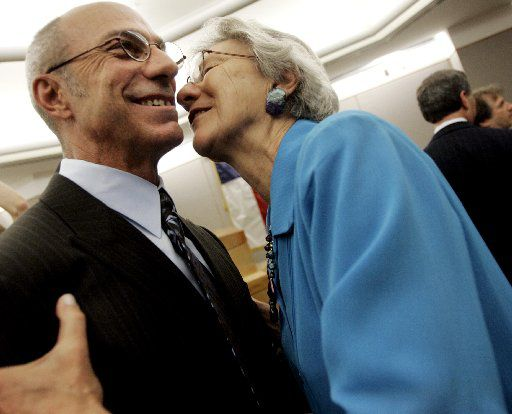 Steven Phillips received a hug and a kiss from his mother, Jerry Lively, after he was exonerated in 2008 during a hearing  in Dallas. After Mr. Phillips spent 25 years in prison, DNA evidenced proved he was not the suspect and did not commit the crimes.  He said his mother stood by him the entire time. (FILE PHOTO)